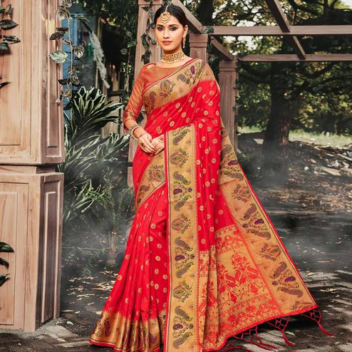 Intricate Coral Red Colored Festive Wear Woven Banarasi Silk Saree With Tassels