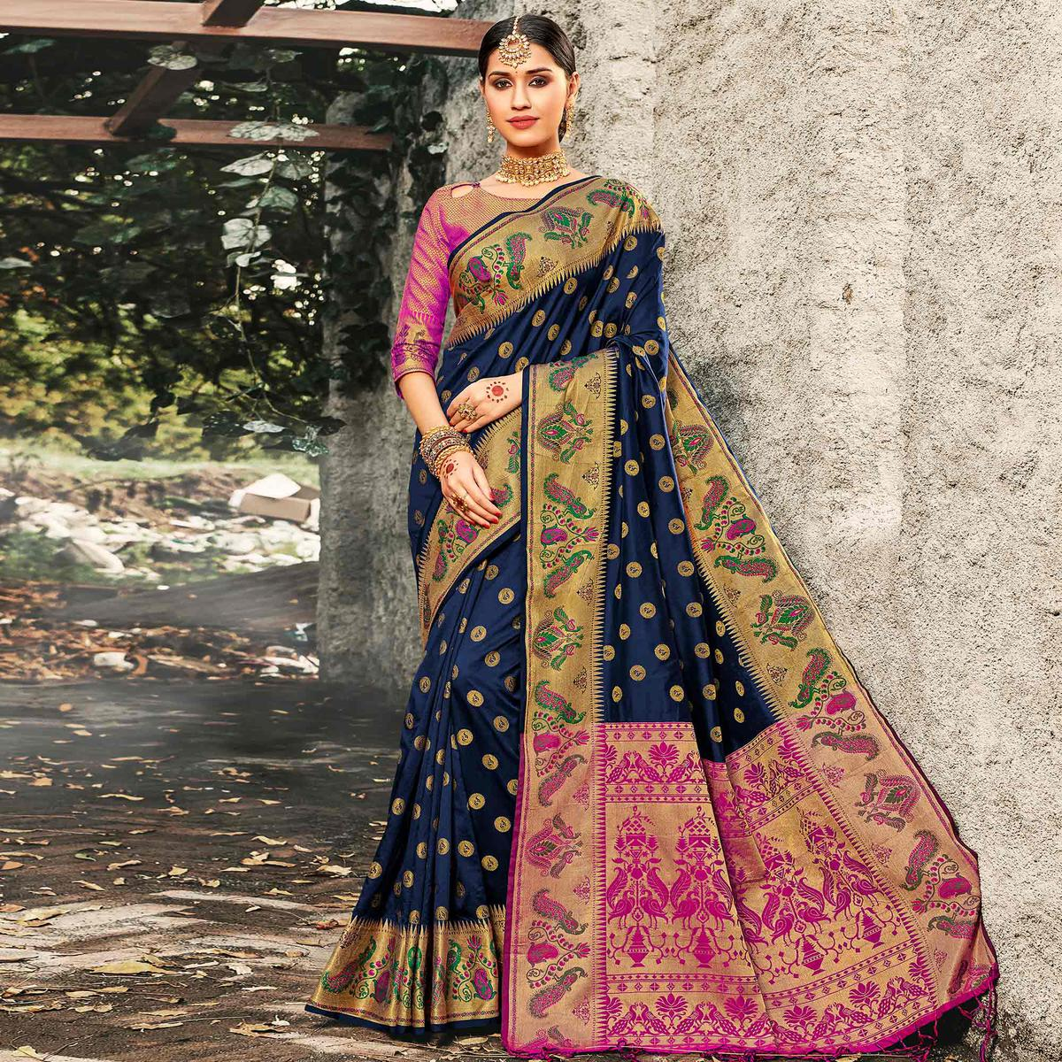 Exotic Navy Blue Colored Festive Wear Woven Banarasi Silk Saree With Tassels