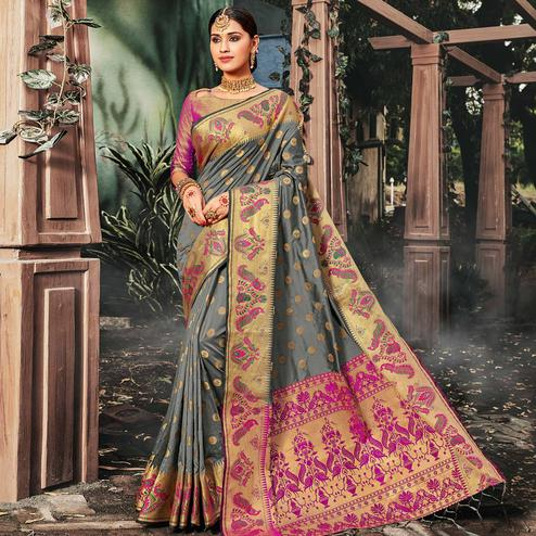Elegant Grey Colored Festive Wear Woven Banarasi Silk Saree With Tassels