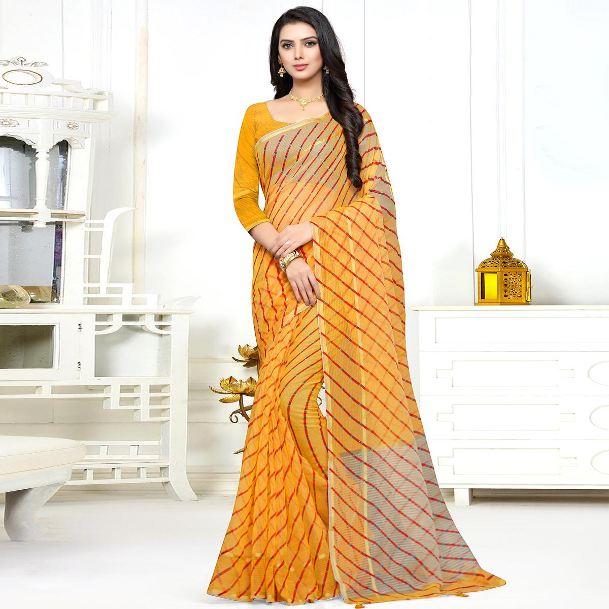 Adorable Yellow Colored Casual Printed Super Net Saree