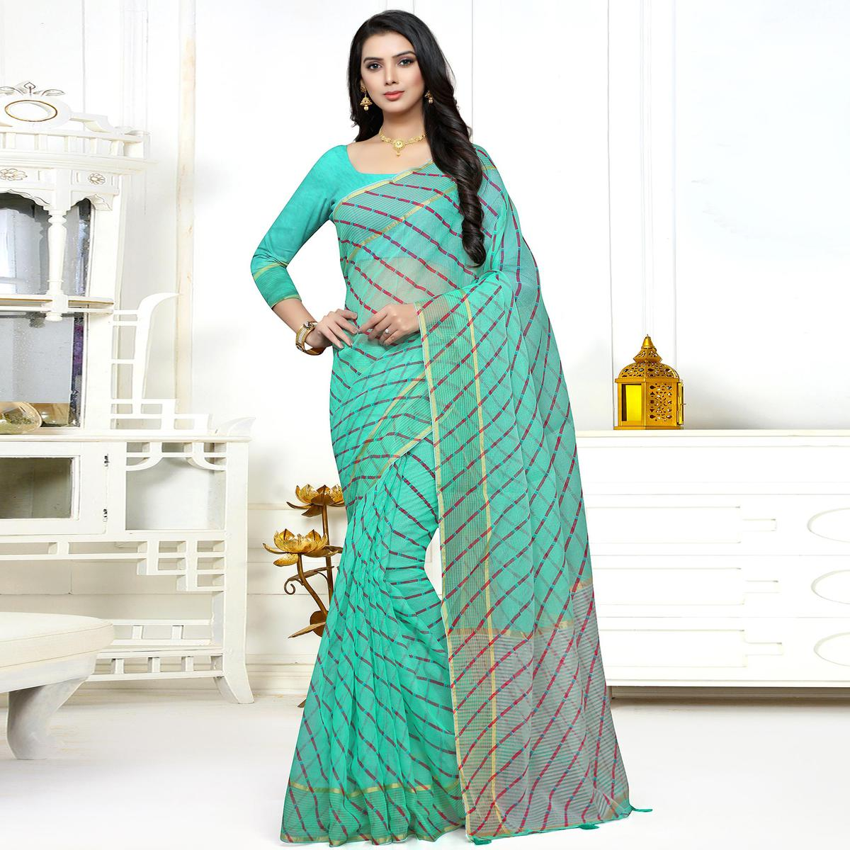 Charming Turquoise Green Colored Casual Printed Super Net Saree