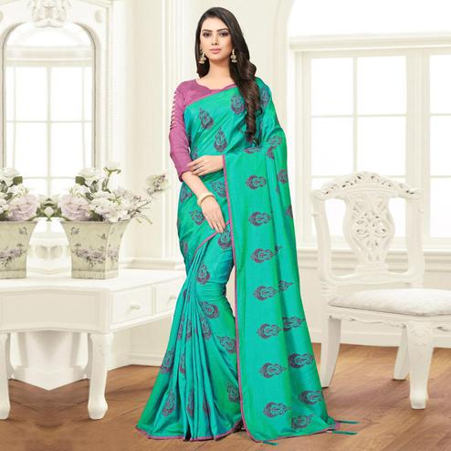 Desirable Turquoise Green Colored Partywear Printed Sana Silk Saree
