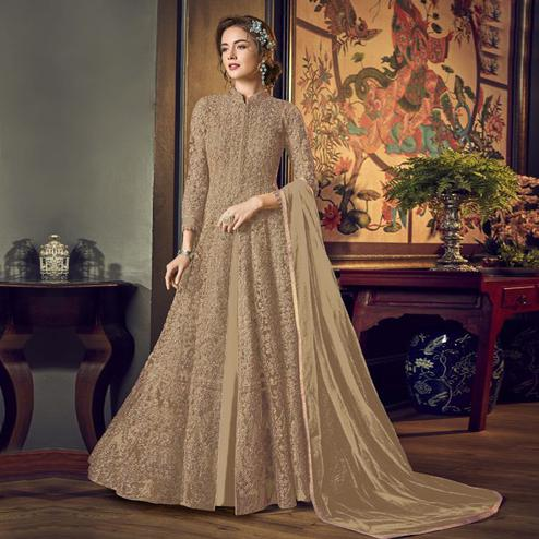Appealing Brown Colored Partywear Embroidered Netted Anarkali Suit