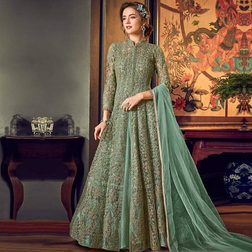 Adorning Mint Green Colored Partywear Embroidered Netted Anarkali Suit