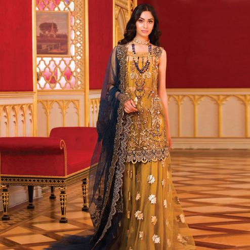 Pleasance Golden Yellow Colored Party Wear Embroidered Net Lehenga Kameez