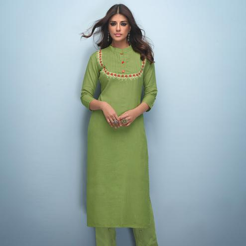 Gleaming Green Colored Partywear Embroidered Rayon Kurti