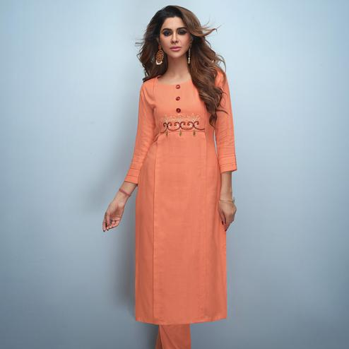 Mesmeric Peach Colored Partywear Embroidered Rayon Kurti