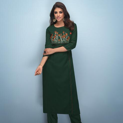Hypnotic Dark Green Colored Partywear Embroidered Rayon Kurti