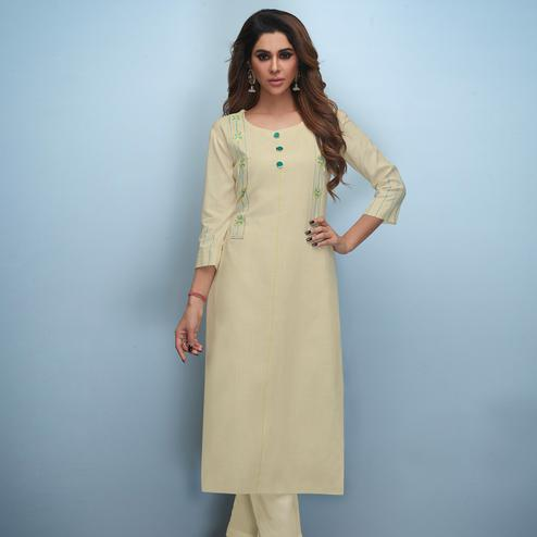 Flattering Cream Colored Partywear Embroidered Rayon Kurti