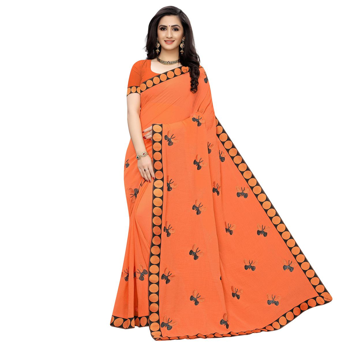 Beautiful Orange Colored Party Wear Embroidered Georgette Saree