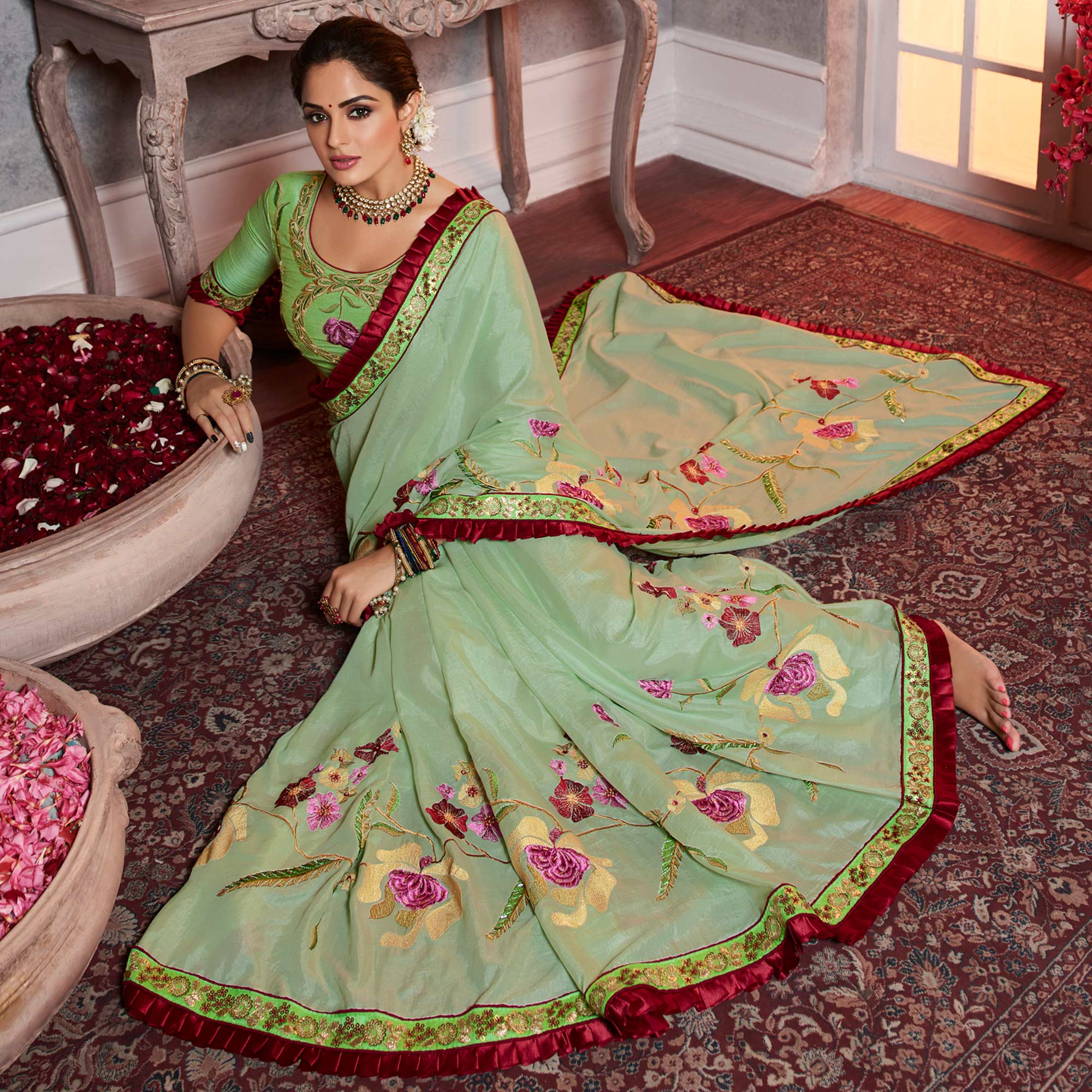 Prominent Pista Green Colored Partywear Embroidered Silk Saree
