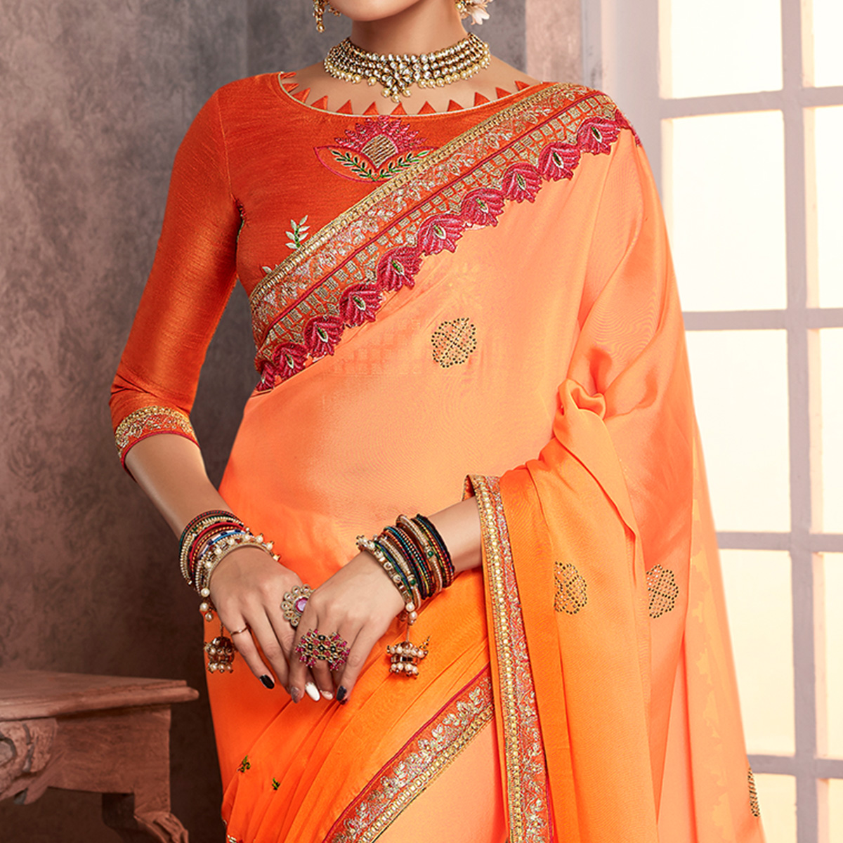 Appealing Orange Colored Partywear Embroidered Silk Saree