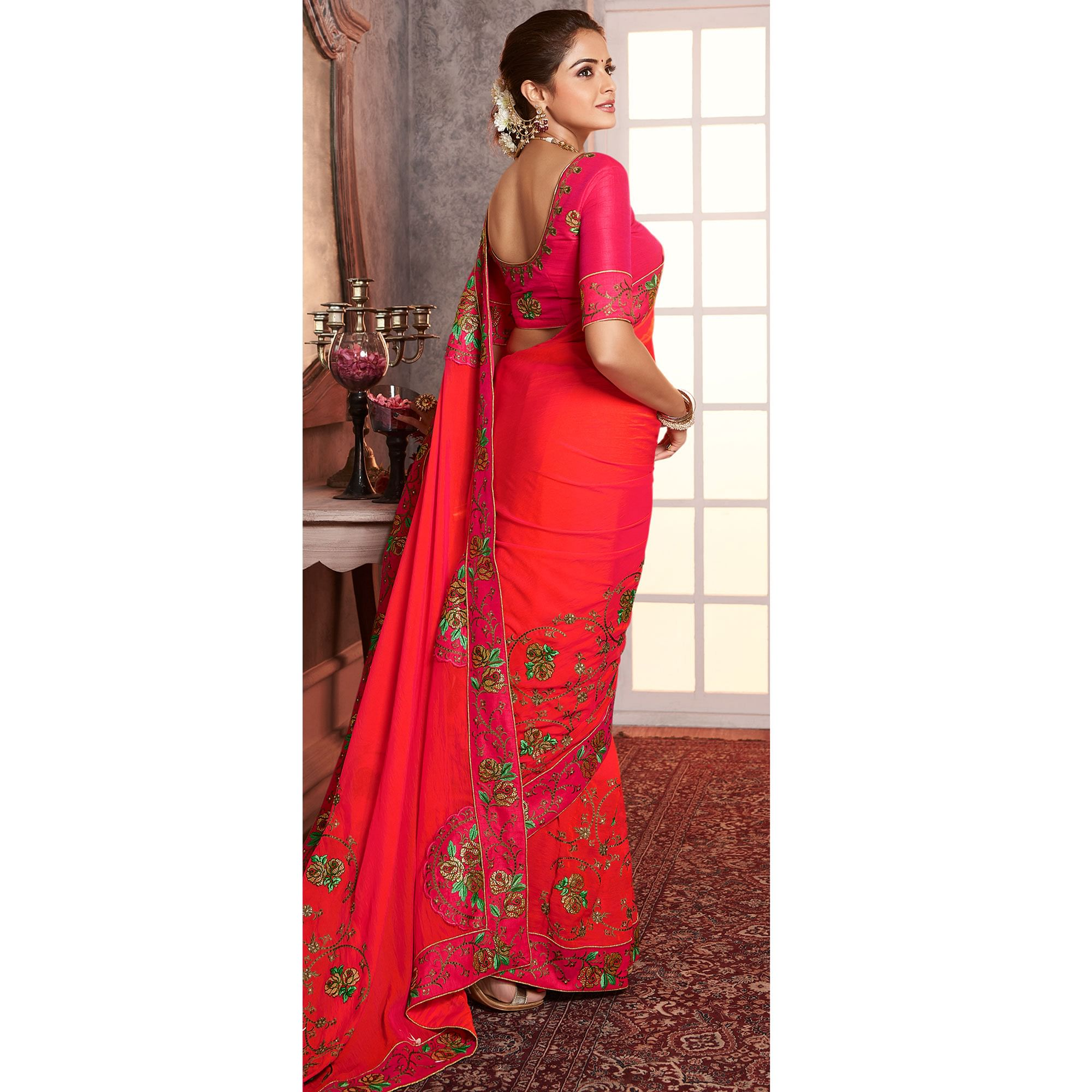 Adorning Dark Peach Colored Partywear Embroidered Silk Saree