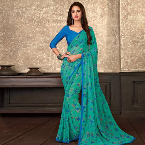 Attractive Blue Colored Casual Wear Floral Printed Georgette Saree