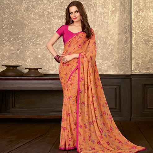 Beautiful Peach Colored Casual Wear Floral Printed Georgette Saree