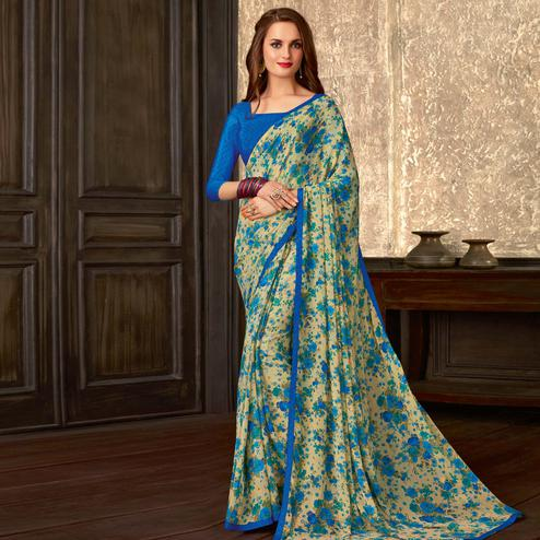 Blooming Beige-Blue Colored Casual Wear Floral Printed Georgette Saree
