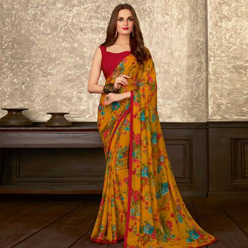 Charming Mustard Yellow Colored Casual Wear Floral Printed Georgette Saree