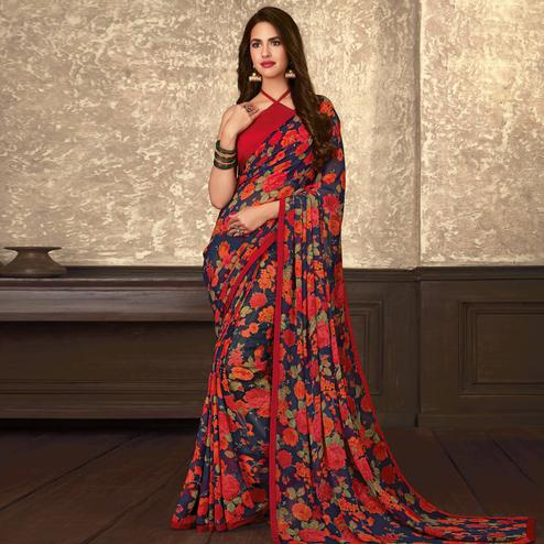 Innovative Blue-Red Colored Casual Wear Floral Printed Georgette Saree