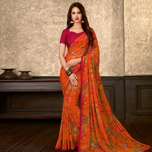 Lovely Orange Colored Casual Wear Floral Printed Georgette Saree