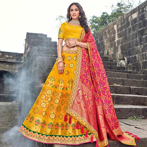Blissful Yellow Colored Partywear Woven Silk Lehenga Choli