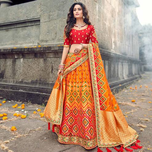 Ideal Red-Yellow Colored Partywear Woven Silk Lehenga Choli