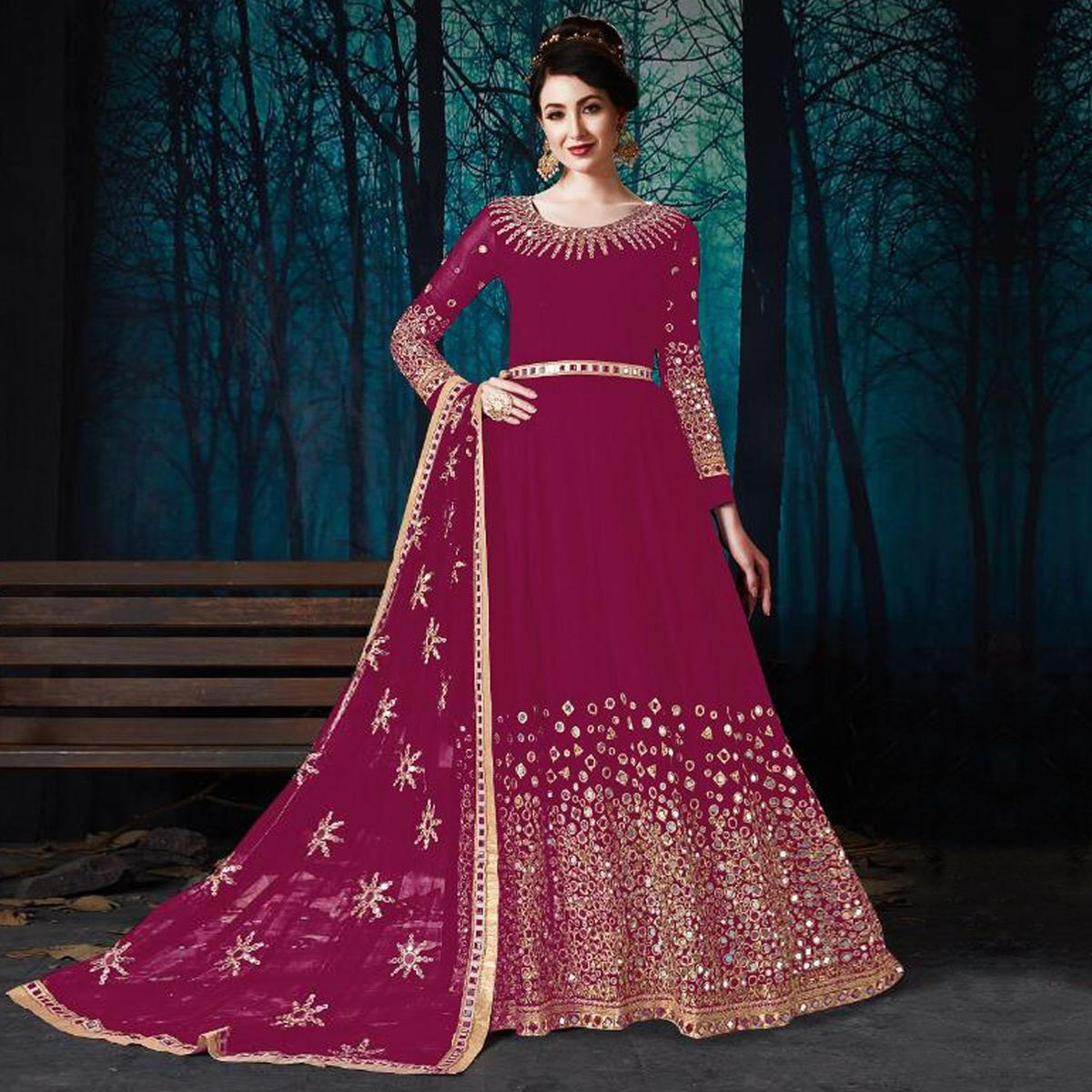 Adorning Pink Colored Partywear Embroidered Georgette Anarkali Suit