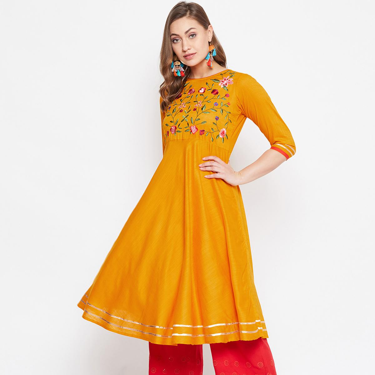 Lovely Orange Colored Party Wear Embroidered Rayon Long Kurti