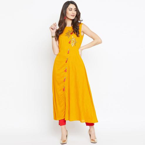 Arresting Mustard Yellow Colored Party Wear Printed Rayon Long Kurti