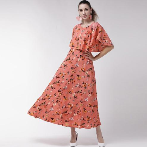 Blissful Peach Colored Partywear Cape Sleeve Floral Printed Crepe Maxi Dress