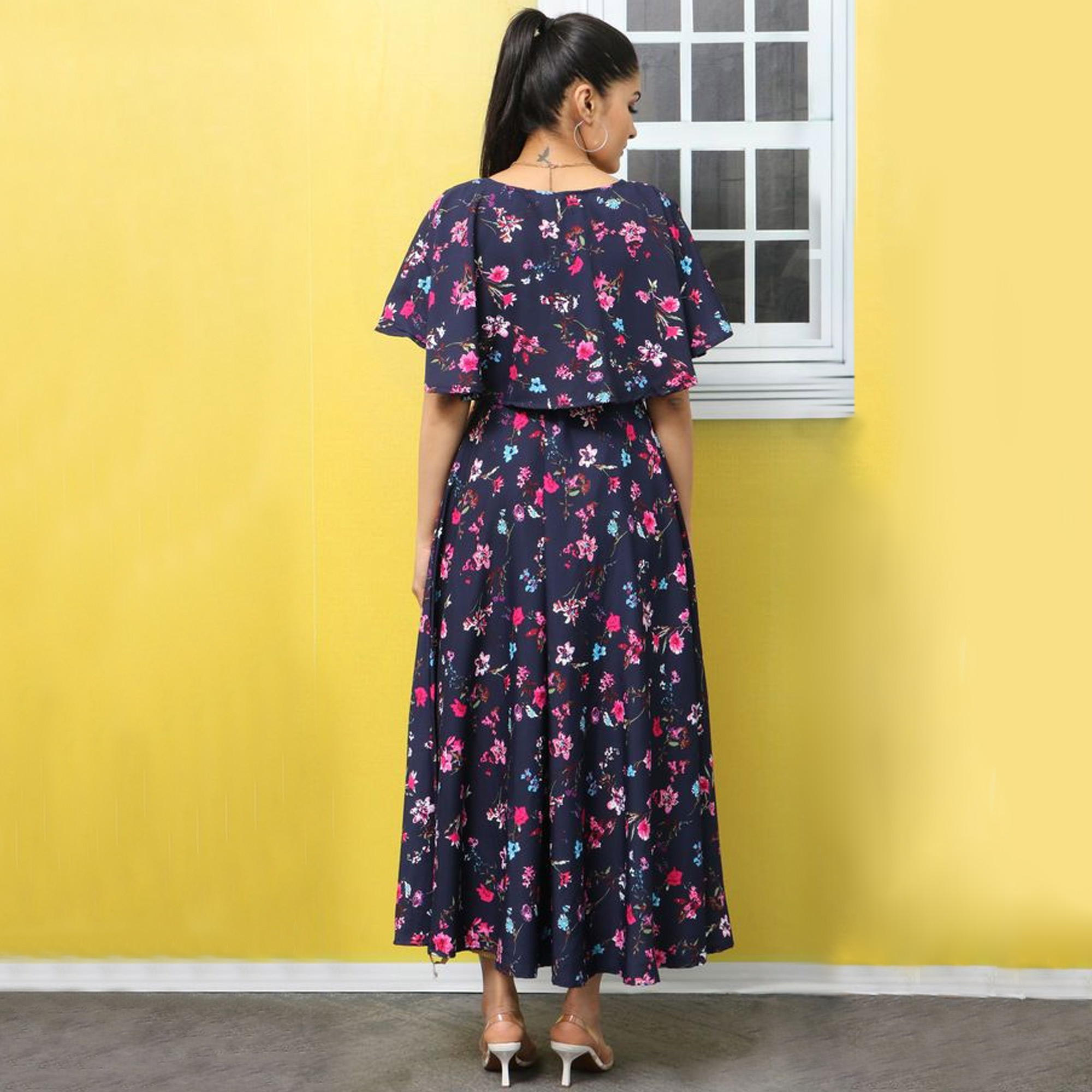 Desirable Dark Blue Colored Partywear Cape Sleeve Floral Printed Crepe Maxi Dress