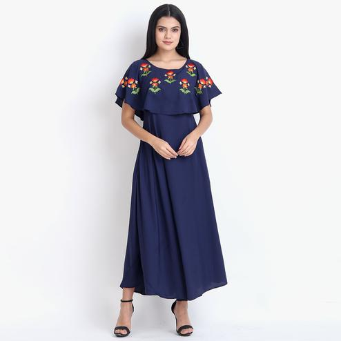 Delightful Navy Blue Colored Partywear Cape Sleeve Floral Embroidered Crepe Maxi Dress
