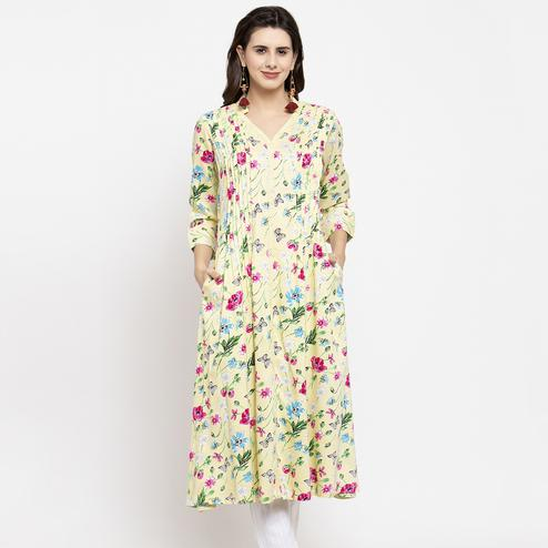 Intricate Light Yellow Colored Casual Wear Floral Printed Cotton Kurti