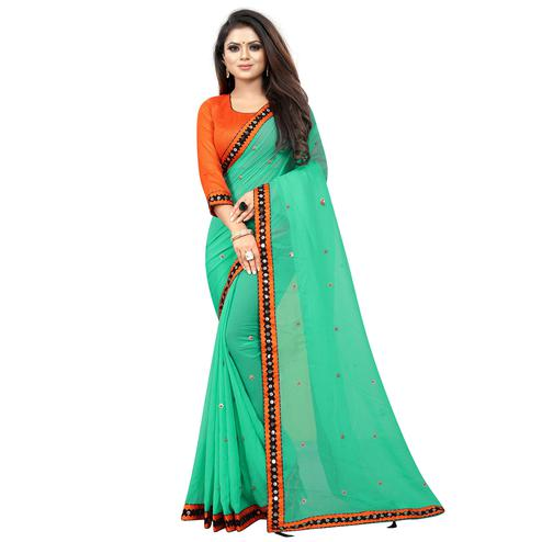 Majesty Rama Green Colored Partywear Embroidered Georgette Saree