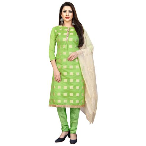 Mesmeric Pista Green Colored Partywear Printed Cotton Blend Dress Material