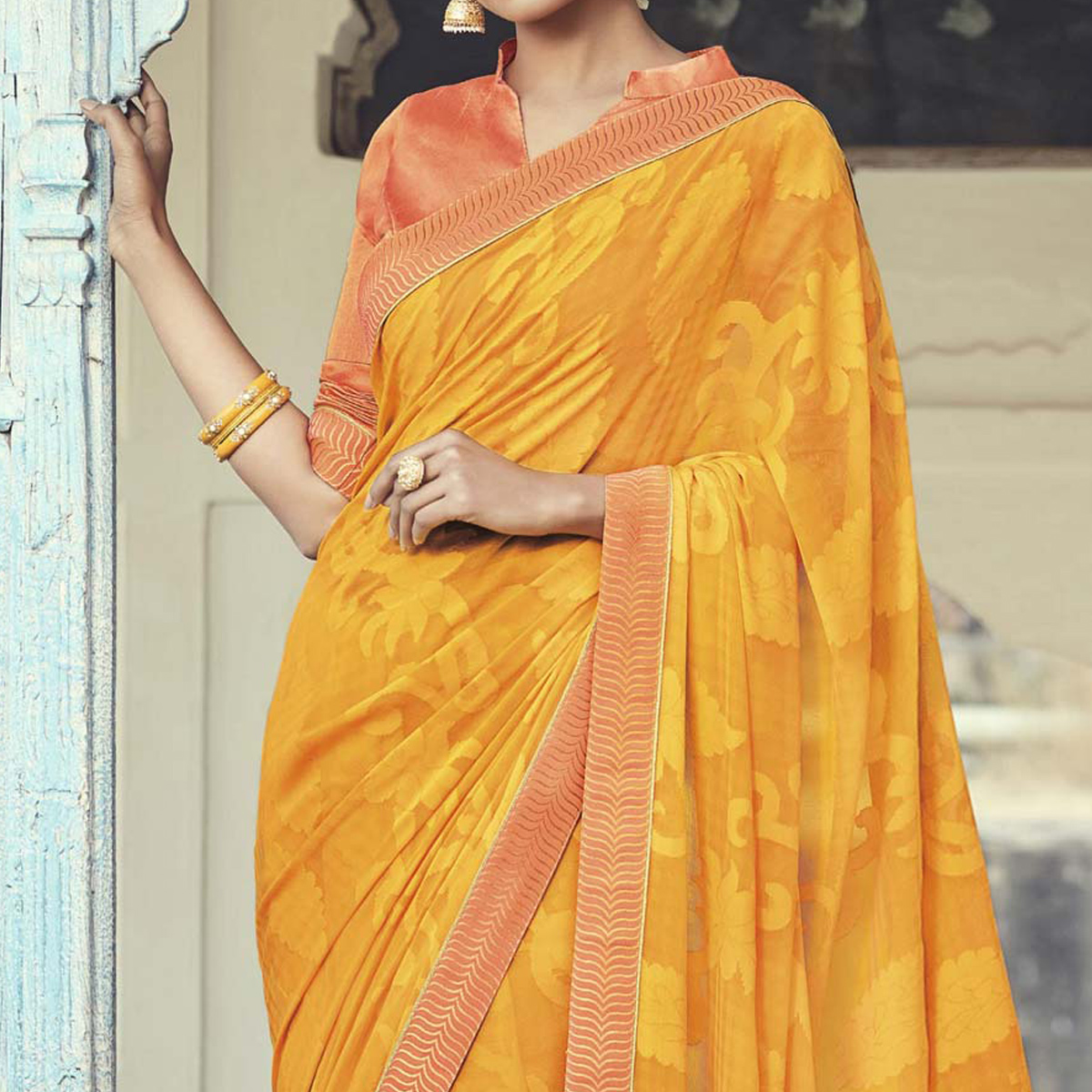 Orange Brasso Print & Lace Border Work Saree