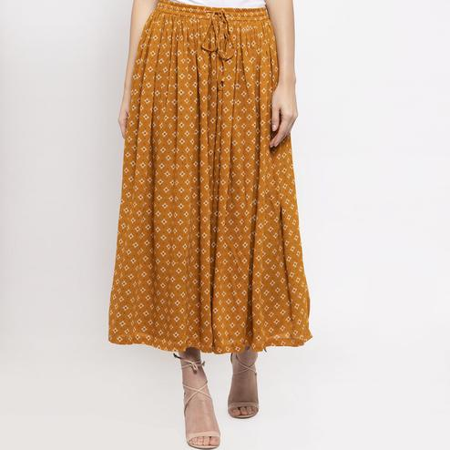 Imposing Mustard Yellow Colored Casual Wear Printed Viscose-Rayon-Crepe Maxi Skirt