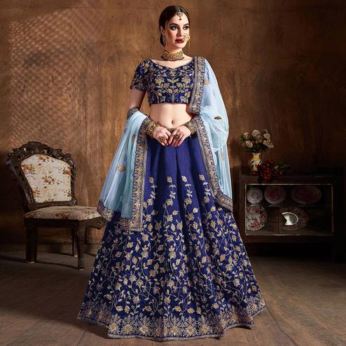 Prominent Navy Blue Partywear Embroidered Raw Silk Lehenga