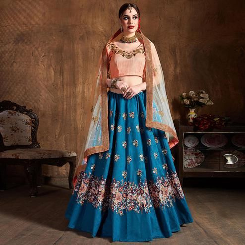 Capricious Teal Blue Partywear Embroidered Raw Silk Lehenga