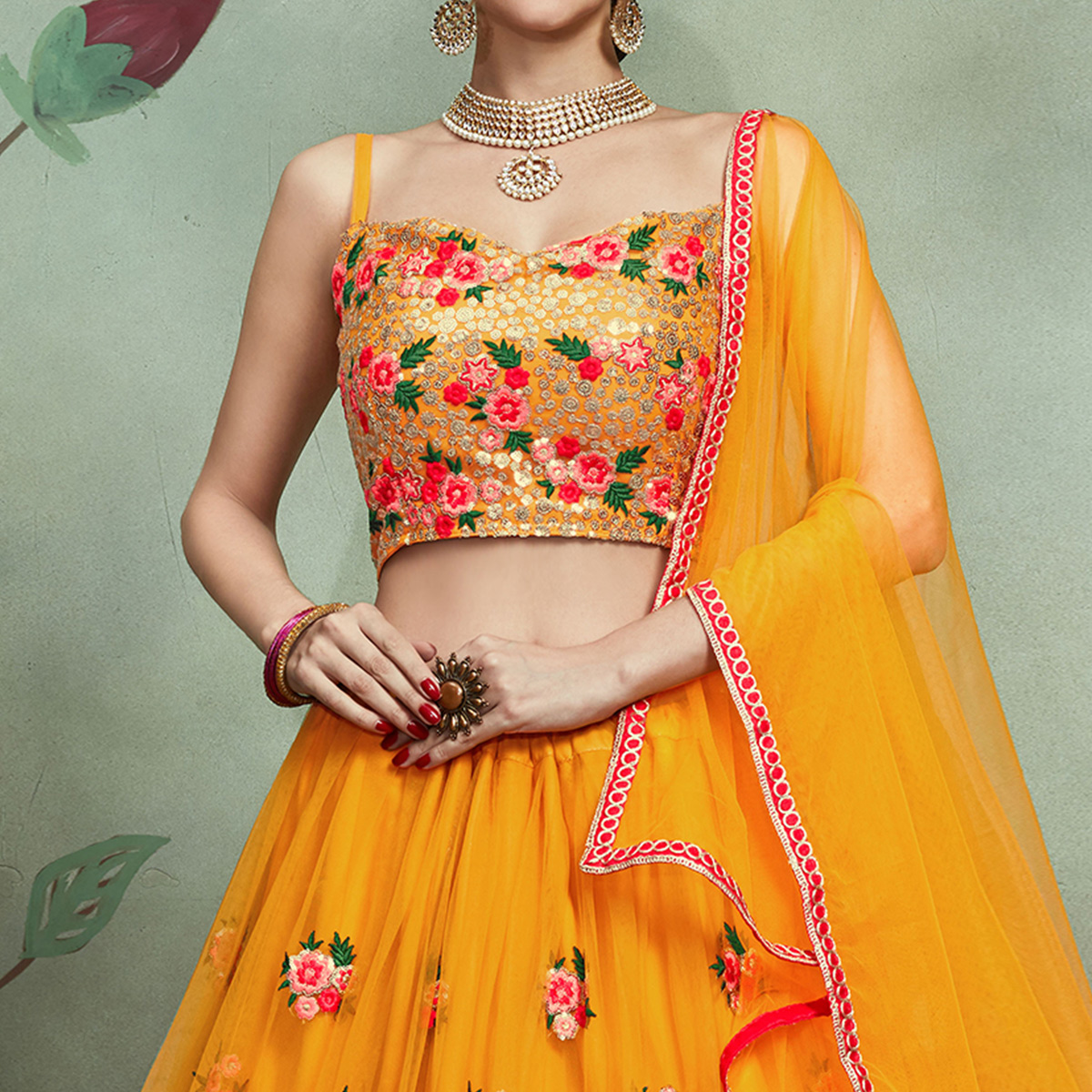 Demanding Mustard Yellow Colored Partywear Embroidered Netted Lehenga