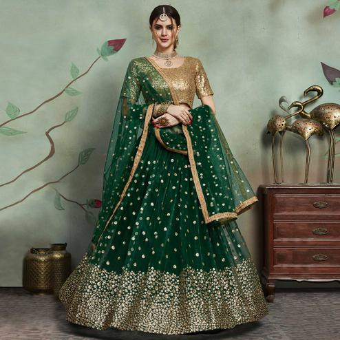 Refreshing Dark Green Colored Partywear Sequins Work Netted Lehenga