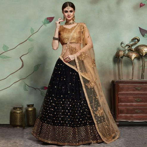 Magnetic Black Colored Partywear Sequins Work Netted Lehenga