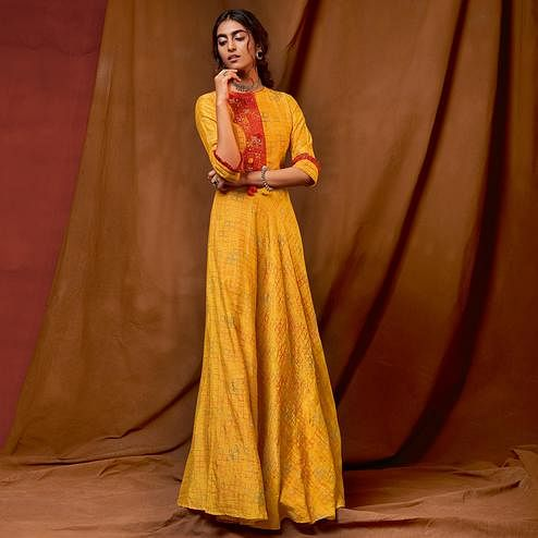 Appealing Yellow Colored Partywear Embroidered-Foil Printed Silk Gown