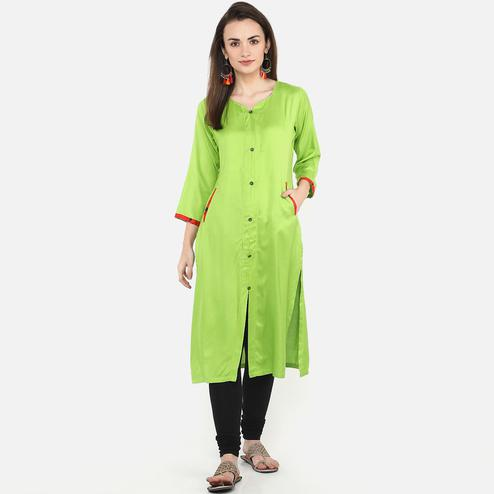 Graceful Parrot Green Colored Casual Wear Pocket Style Rayon Kurti