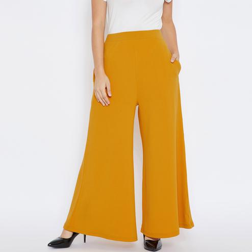Charming Mustard Yellow Colored Casual Wear Solid Crepe Palazzo
