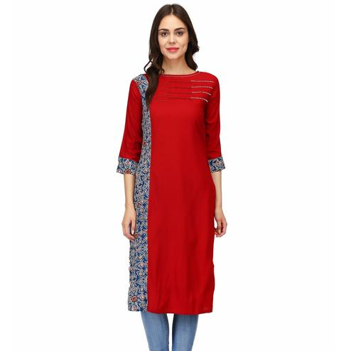 Charming Red Colored Casual Wear Solid Calf Length Rayon Straight Kurti