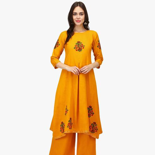 Ethnic Yellow Colored Casual Wear Solid Calf Length Cambric Cotton A-Line Kurti