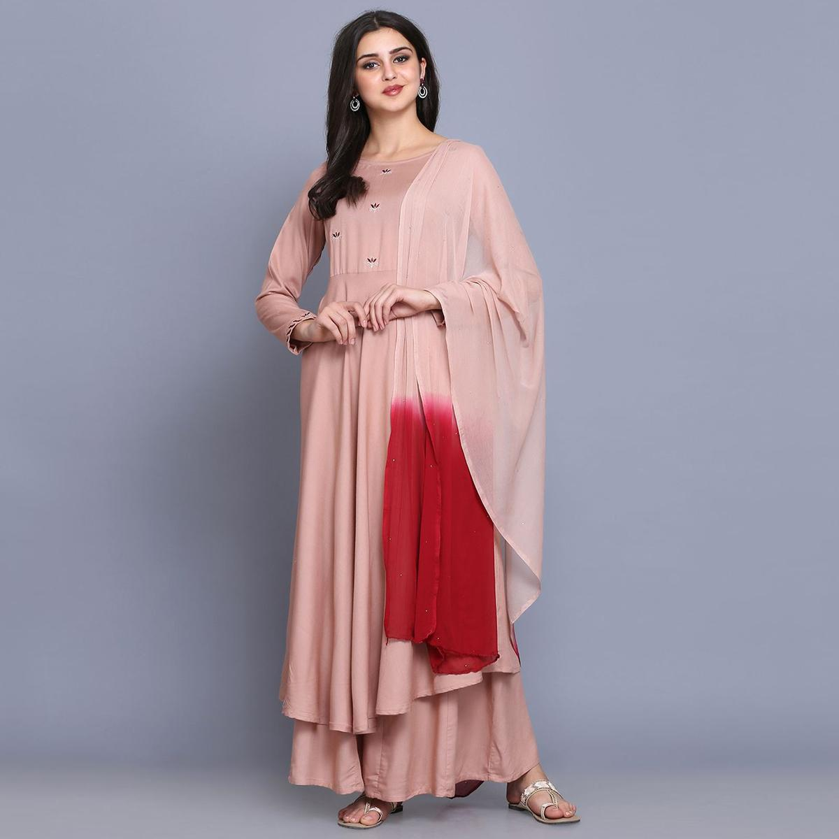 Refreshing Peach Colored Party Wear Embroidery Work Rayon Flared Kurti-Palazzo Set With Dupatta