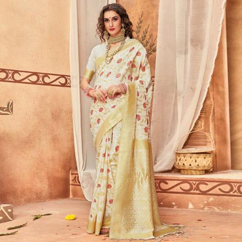 Unique Cream Colored Festive Wear Woven Silk Blend Saree With Tassels
