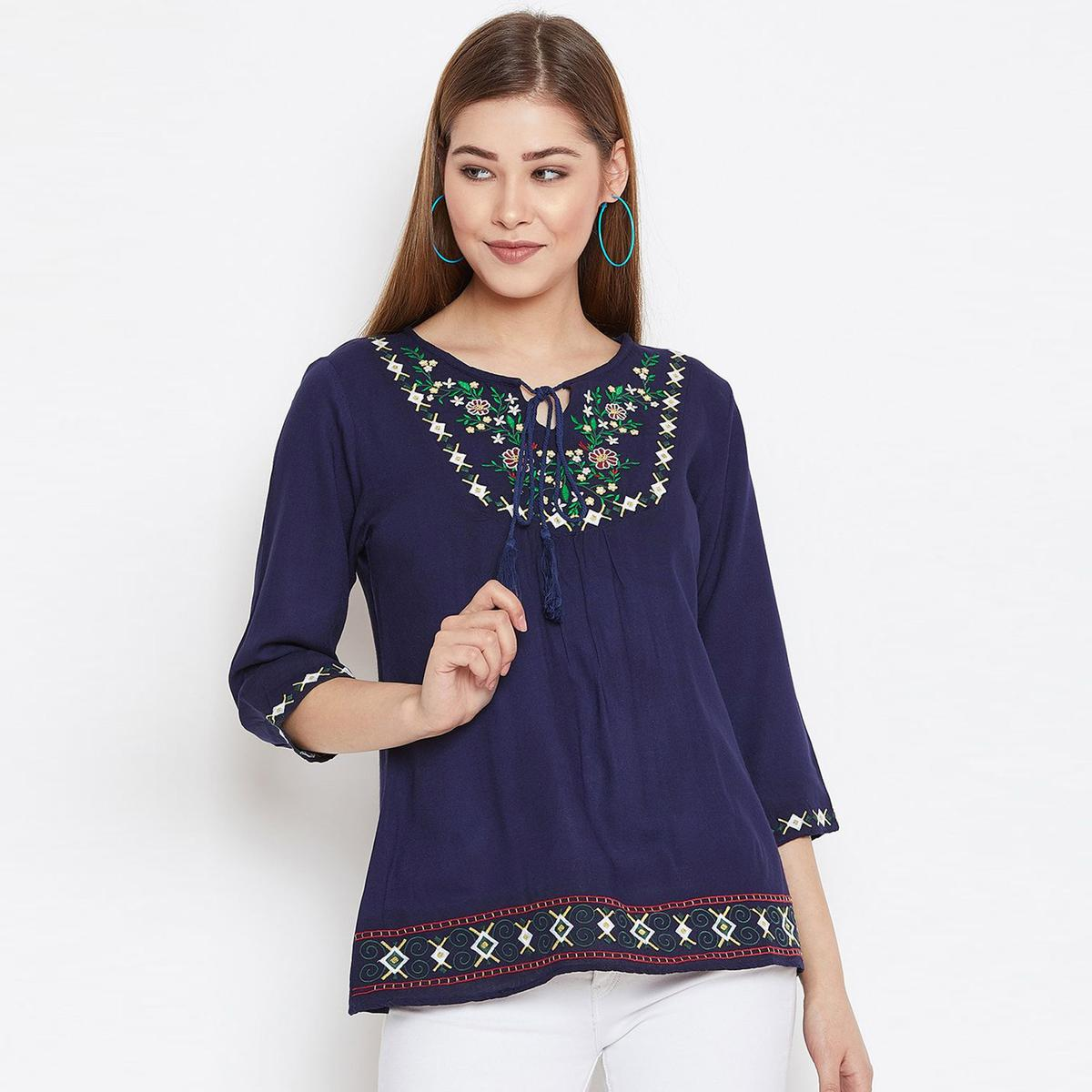 Engrossing Blue Colored Casual Wear Floral Embroidered Rayon Top