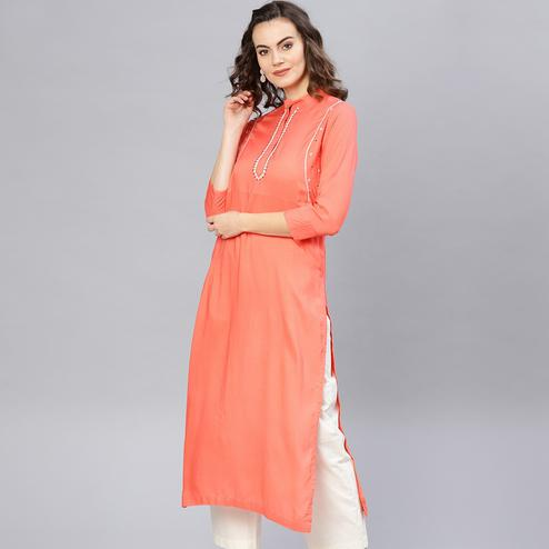 Mesmeric Peach Colored Casual Wear Rayon Kurti